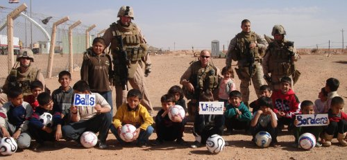 Picture: Happy recipients of a ball shipment to the Iraq-Jordanian border; photo courtesy of US Marines Corps Special Operations Team